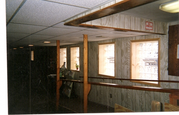this is the inside view of previous photo. we even had to cut through the paneling and stud wall. We trimed out the windows with a clear staind pine with a nice pine casing.